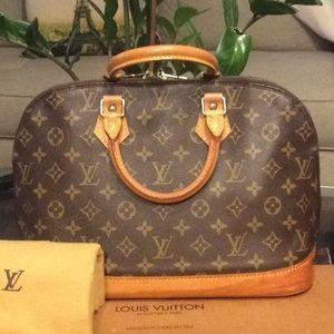 Authentic LV Alma bag w dustbag